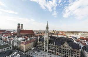 Grand view of Marienplatz City Hall and Cathedral Towers over the blue sky